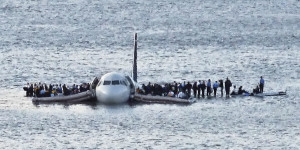 In this Thursday Jan. 15, 2009 file photo, airline passengers wait to be rescued on the wings of a US Airways Airbus 320 jetliner that safely ditched in the frigid waters of the Hudson River in New York, after a flock of birds knocked out both its engines. The audio recordings of US Airways Flight 1549, released Thursday, Feb 5, 2009 by the Federal Aviation Administration, reflect the initial tension between tower controllers and the cockpit and then confusion about whether the passenger jet went into the river. (AP Photo/Steven Day)